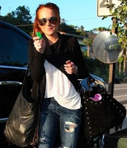 lindsay-lohan-black-suede-bag-and-janey-chain-fringe